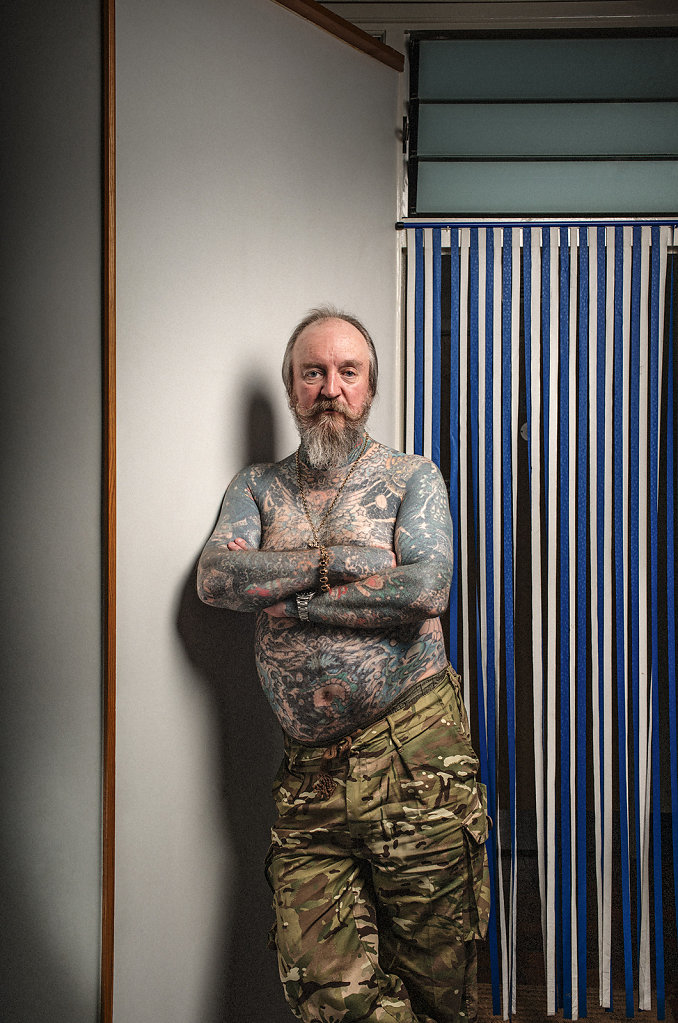 Mark Pettigrew, Tattooist, in his studio